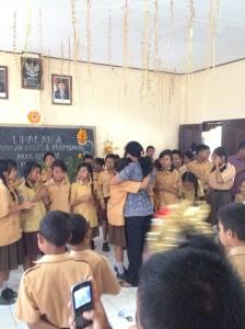 Komang hugging her principal