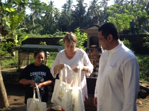 Felicity and Indra delivering goody bags to our neighbors.