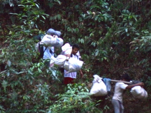 Our porters carried their stuff in rice bags hung on bamboo poles.
