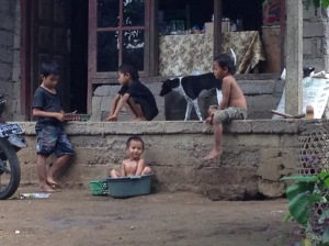 Taking a bath with water from new water pipe built by Bali Regreen